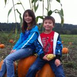 The kiddos hunting for their many pumpkins